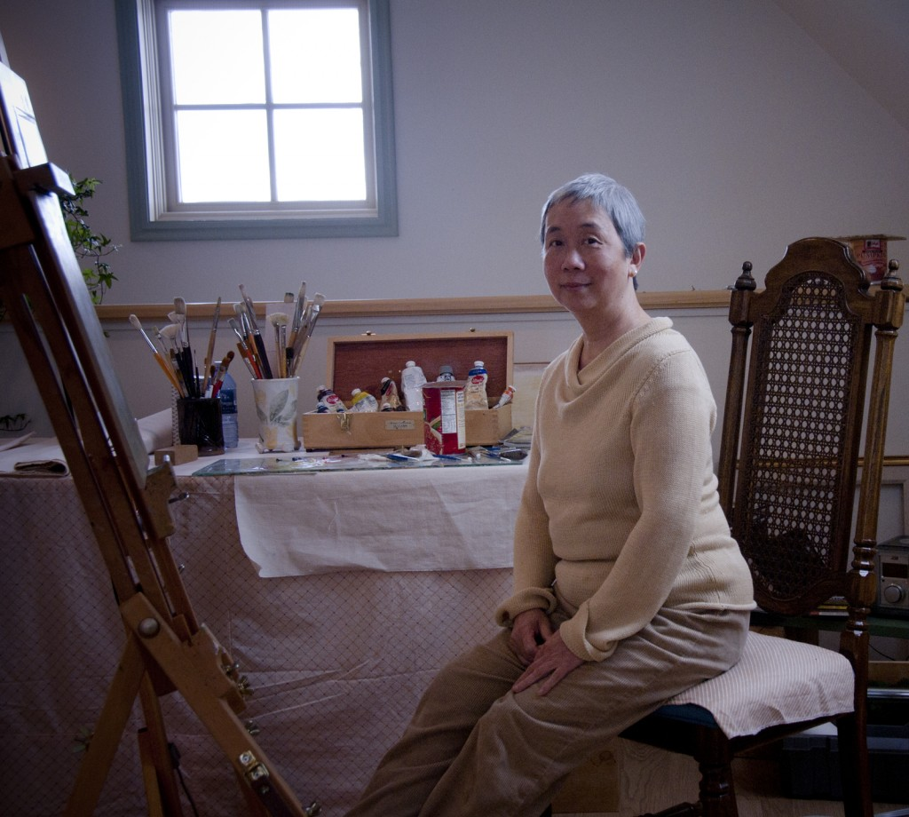 Cassandrea Parson sits in front of her easel in her Spring City studio, photo by Bill Fulton