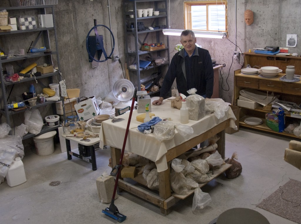John Parson stands in his ceramic studio in Spring City, photo by Bill Fulton