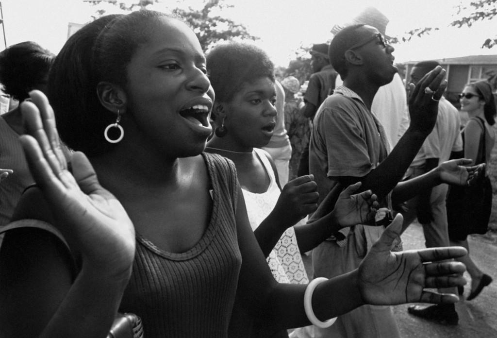 Marchers sing freedom songs en route to Jackson. Photo by Matt Herron, 1966.
