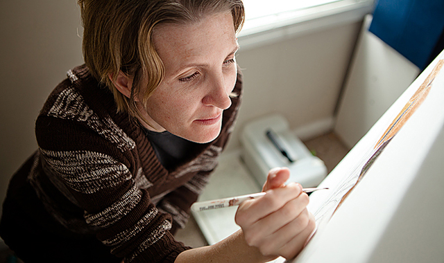 Utah artist Marci Erspamer paints in her studio. Photo by Simon Blundell.