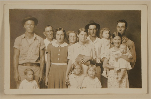 Untitled [large family group] by Mike Disfarmer. Gelatin silver process, paper Dimensions: image: h: 3 in x w: 5 in Credit: Purchased with funds from Dr. Donald L. and Alice A. Lappé and Drs. Daniel and Noemí P. Mattis