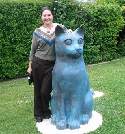 """Dale Thompson with a """"Dairy Cat"""" by Utah sculptor Day Christensen, who she profiled in the July 2012 edition of 15 Bytes."""