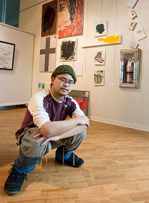 Qi Peng in front of his work at the IOA Gallery