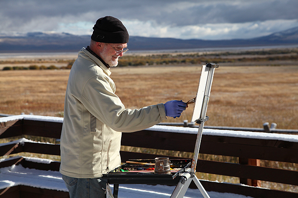 Bill Fulton painting a snow scene during the Centennial Valley Celebration of the Arts