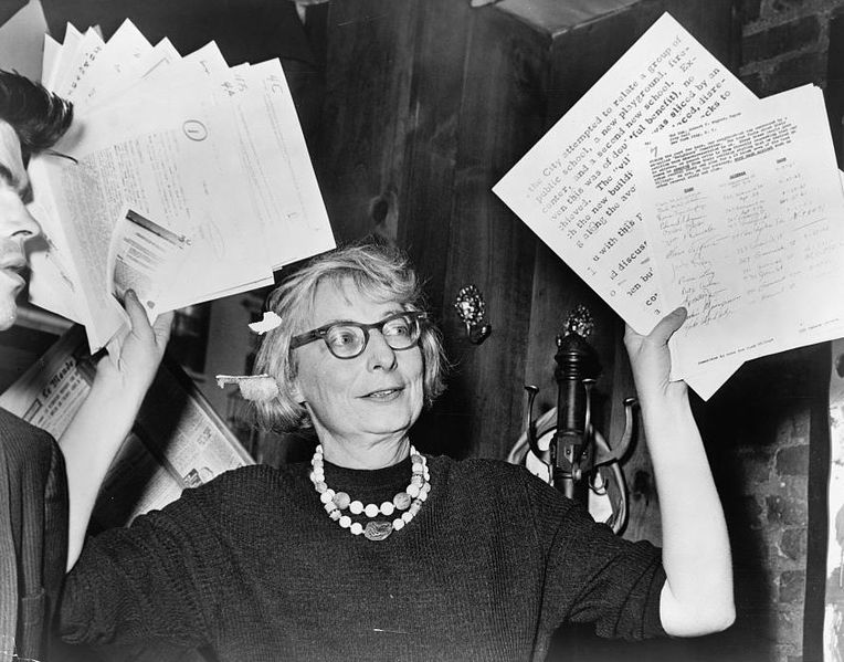Mrs. Jane Jacobs, chairman of the Comm. to save the West Village holds up documentary evidence at press conference at Lions Head Restaurant at Hudson & Charles Sts.