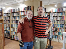 Andy Hoffman (left) and author Tom Peters in his Beat Book Shop, Boulder, Colorado.