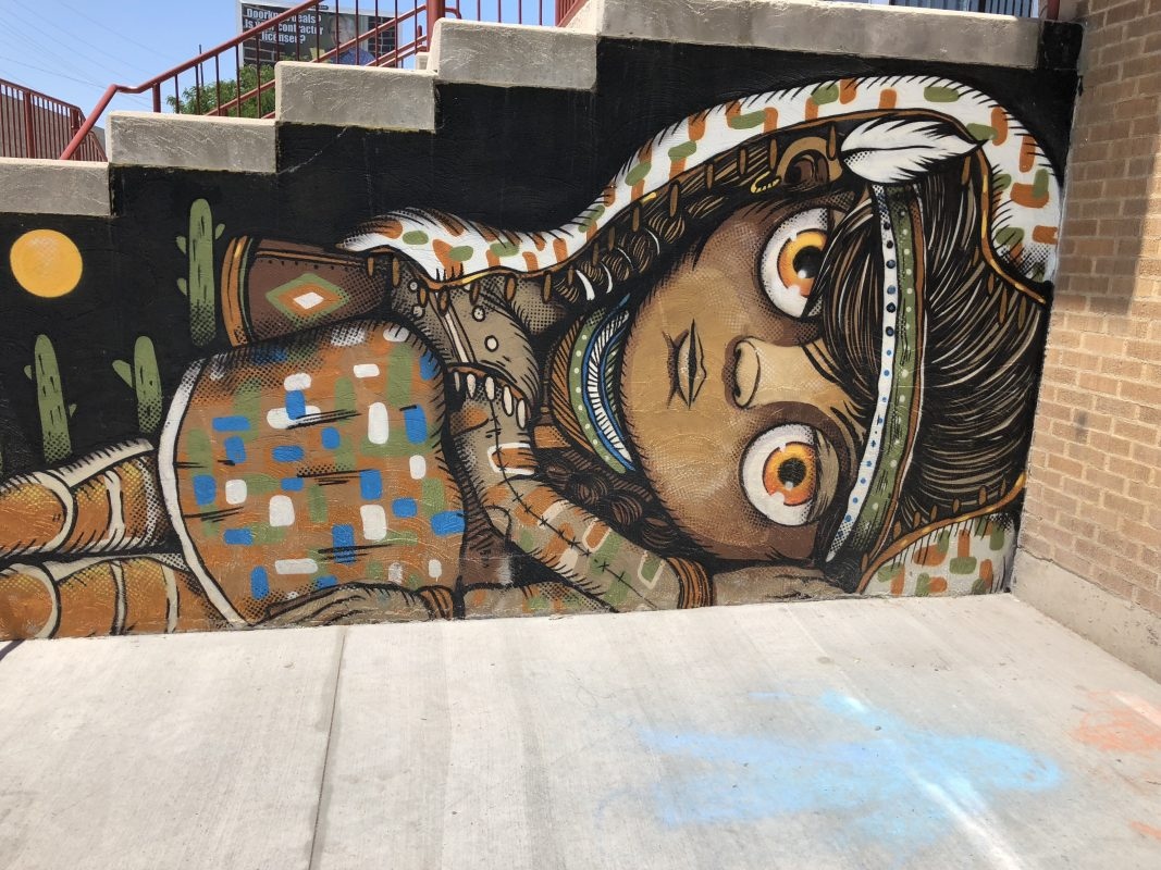 Mural painting on the steps of the Indian Walk-in Center in Salt Lake City, featuring a young girl.