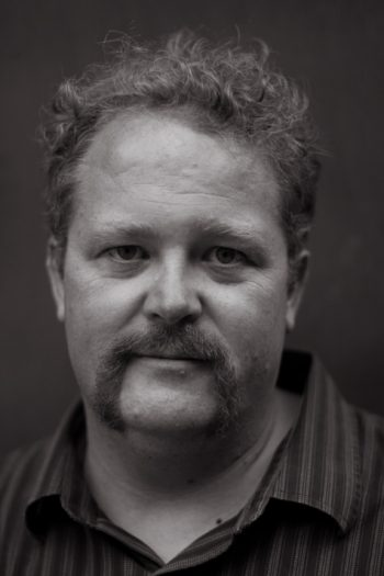 Todd Robert Petersen, self-portrait, taken near his shed with a 50mm prime lens.
